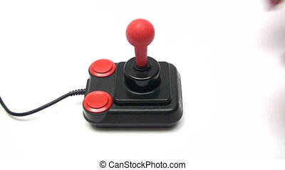 Gaming - Playing with a retro joystick White background...