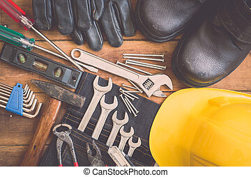 Assorted work tools on wood - Close up of assorted work...