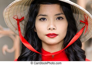 Pretty Vietnamese woman in a straw hat