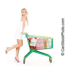 shopper - happy woman with shopping cart over white