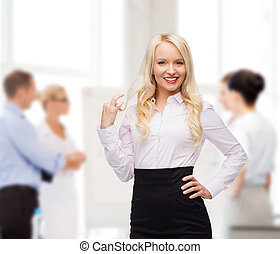 smiling businesswoman or secretary in office - business,...