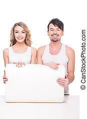 Mattress - Beautiful young couple with quality soft pillow...