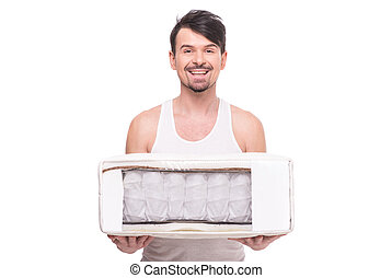 Mattress - Young man with nice, quality mattress that...