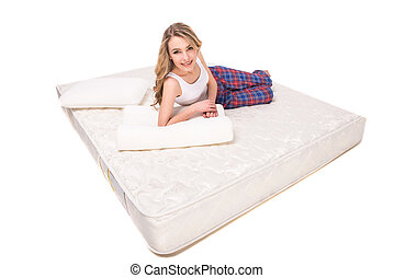 Mattress - Young, smiling woman is lying on the quality...