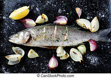 Roasted Sea Bass on a dark background, sefood