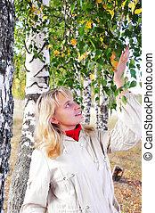 happy girl at a white birch
