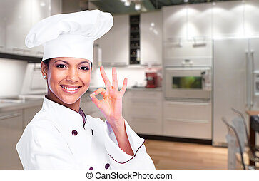 Chef woman. - Smiling chef woman in a modern kitchen