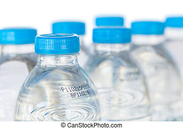 Drinking water bottle with expiration date isolated on white...