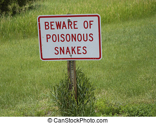 Watch Out for Snakes - A sign cautioning walkers of the...