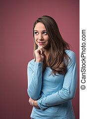 Smiling pensive young woman
