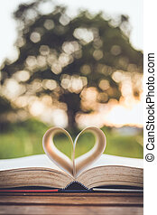 Close up book with heart symbol on table, retro color