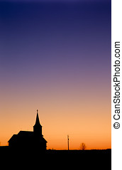Church After Sundown - The silhouette of a country church is...