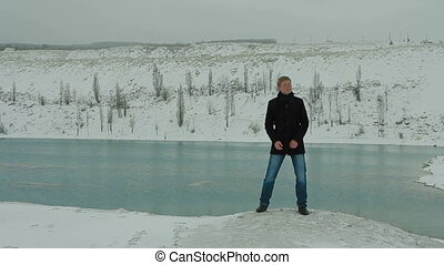 Young Man Singing At Winter Lake - Young man in formalwear...