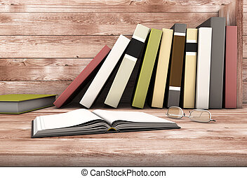 The open book and glasses against the wooden shelf with...