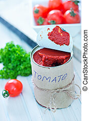 tomato sauce in metal bank and on a table