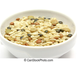 Mixed lentils with brown rice in a bowl of chinaware