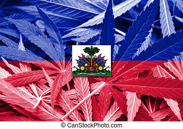 Haiti Flag on cannabis background. Drug policy. Legalization...