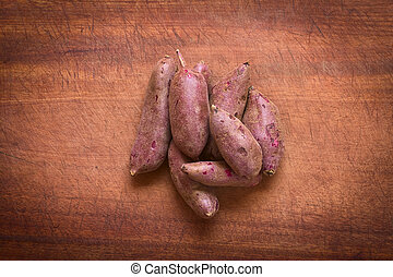 Purple Sweet Potato - Overhead shot of raw purple sweet...