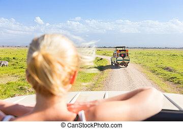 Woman on african wildlife safari.