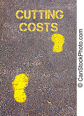 Yellow footsteps on sidewalk towards Cutting costs message