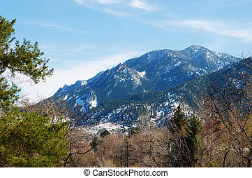 Scenic Snowy Mountain in Springtime - Flatirons mountain...
