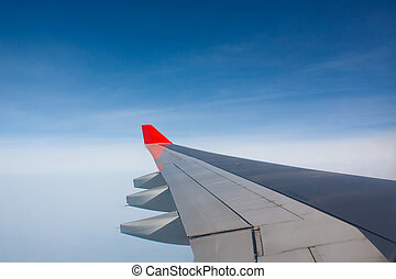 Plane wing - View from window of plane to wing in airbone