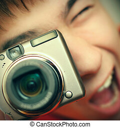 Teenager with Photo Camera - Toned Photo of Surprised...
