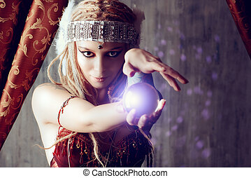 foretell - Magnificent fortune teller holding crystal ball...