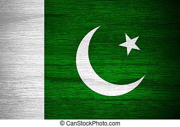 Pakistan flag or Pakistani banner on wooden texture