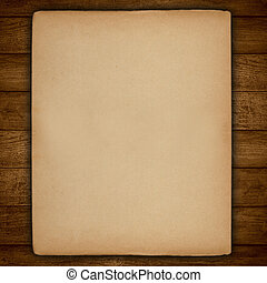 vintage sheet of paper with rough edges on wooden background