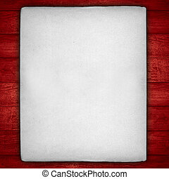 vintage white sheet of paper with rough edges on red wooden...