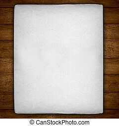 vintage white sheet of paper with rough edges on brown...