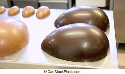 Easter eggs chocolate on worktop pastry