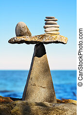 Symmetrical - Balance of pebbles on the top of triangle...