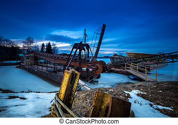 Dredging in the winter position on a frozen lake.