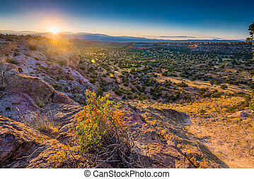 Twankawi Sunrise - Golden sunrise over Bandelier National...