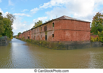 Kronstadt canal with old building and blue sky background