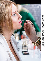 Bride during wedding makeup - Young bride during wedding...