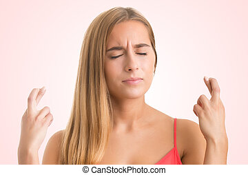 Woman Crossing Her Fingers For Good Luck - Woman crossing...