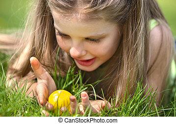 Child find easter egg outdoor. - Little girl find easter egg...