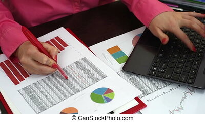 checking budget - woman checking budget or payroll with...