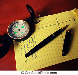 Compass pen and notebook