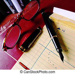 Glasses pen and notebook b