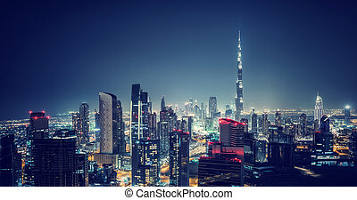 Beautiful Dubai cityscape, bird's eye view on a night urban...