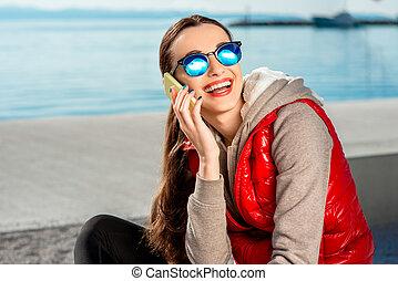 Sport woman on the promenade - Sport woman dressed in warm...