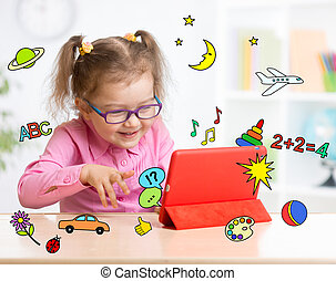 Kid with tablet computer in glasses. Early education. - Kid...