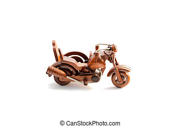 Wooden motor tricycle is isolated on white background