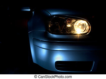 Car with lights on - Front end and light of a blue car