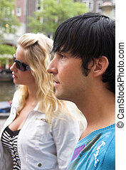 profile portrait of young adult couple outdoors