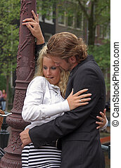 Young embracing adult couple - Young adult couple embracing...